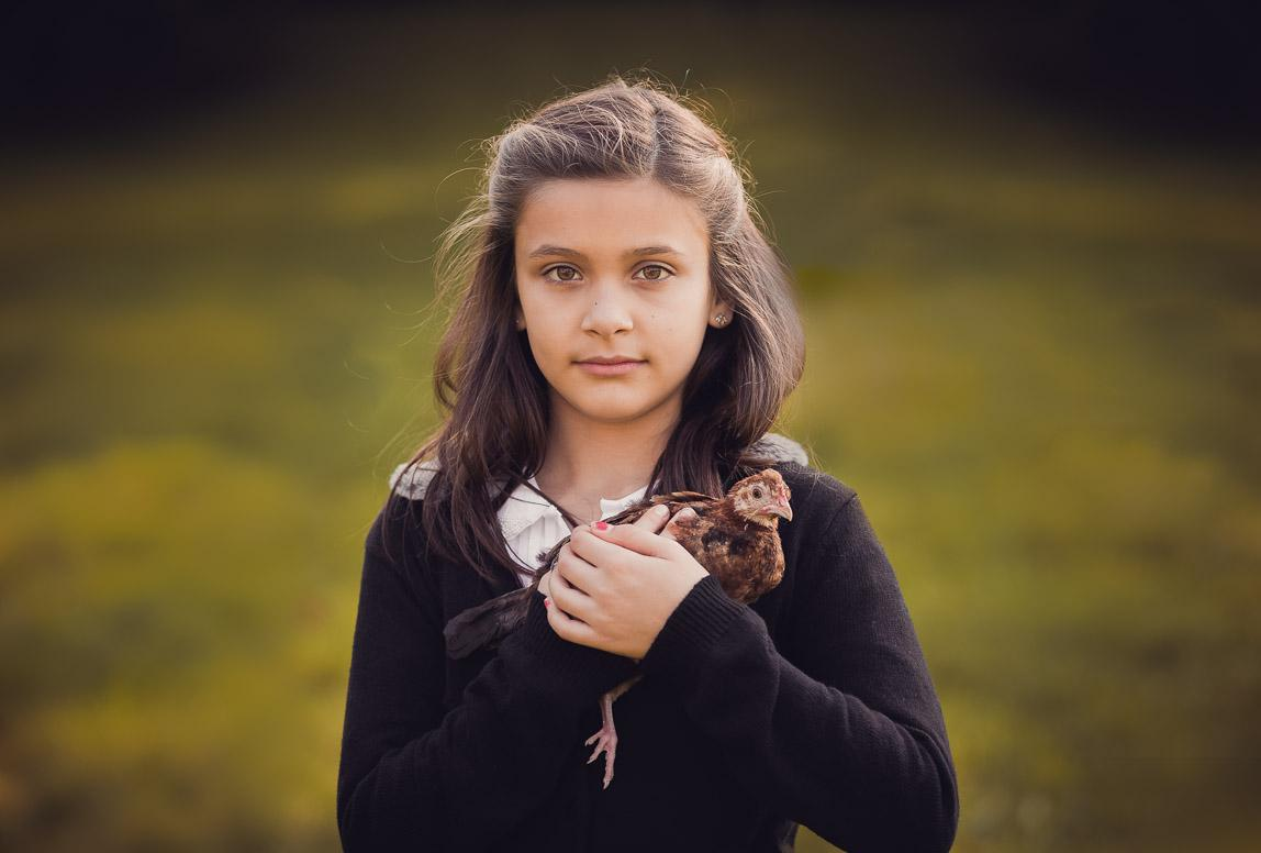 mallorca portrait photography - little girl holding a chicken