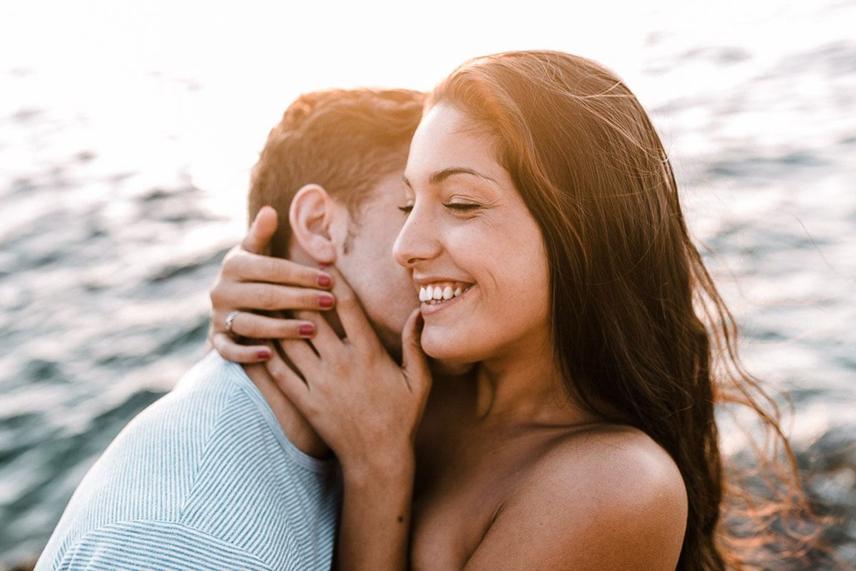 engagement photographer mallorca - Romany Flower - playful couple at the beach
