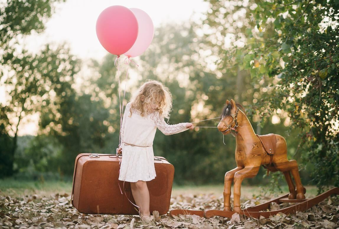 Chile family photographer  Romany Flower: artistic children portrait of girl with wooden horse