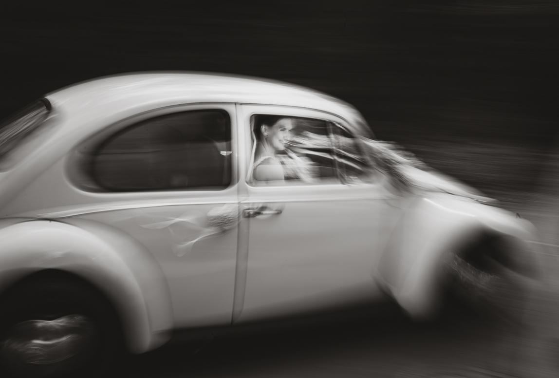 artistic photo of bride in a white car take by Chile wedding photographer Romany Flower