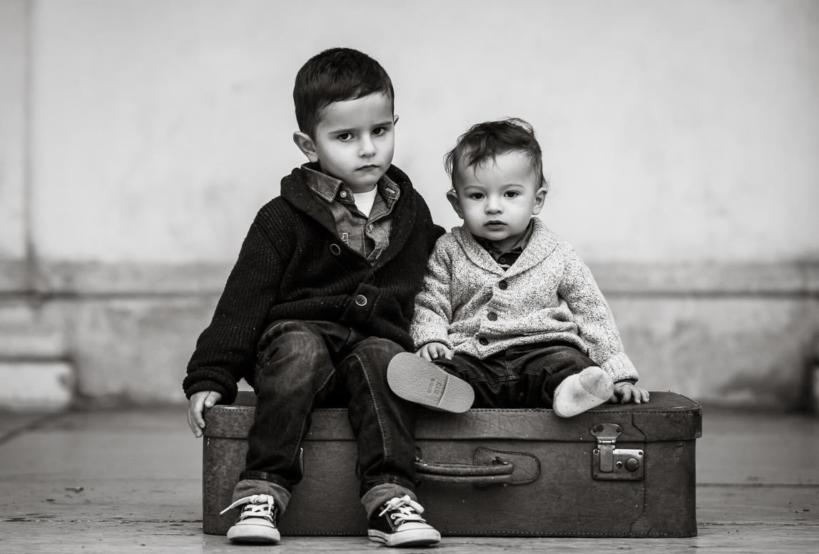 kids portrait by Photographer in Chile: siblings portrait in b&w