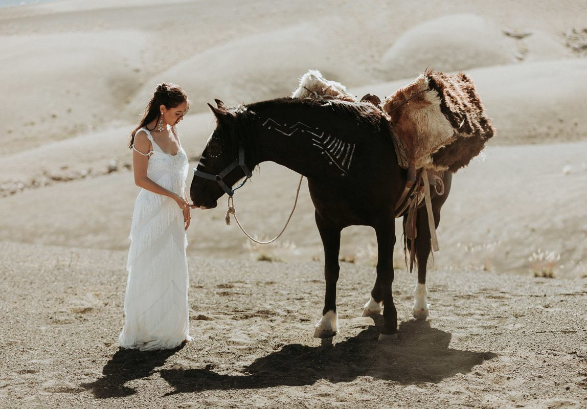photographer in Chile: bride with horse in the pristine wilderness of the Chilean mountains
