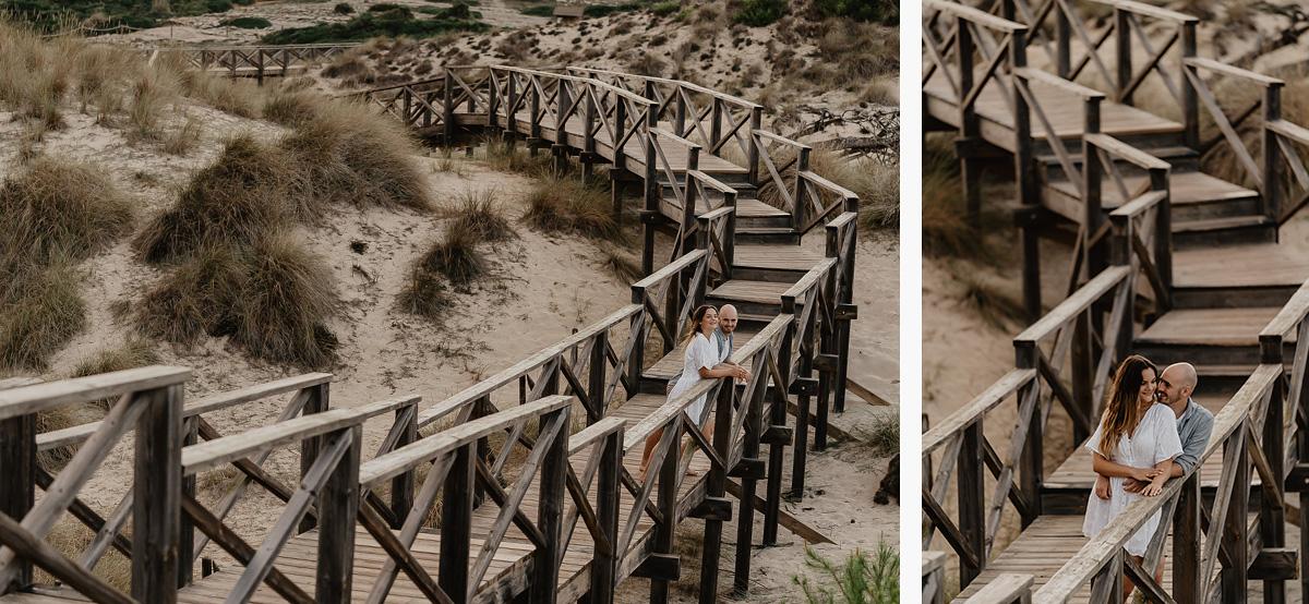 Couple during romantic photo shooting on wood jetty at cala mesquida - photo by cala Rajada photographer Romany Flower